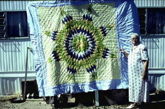 The late Mrs. Lula Edge of St. David, Arizona, with a quilt she and her granddaughter had made the previous summer. April, 1980  [image courtesy of James S. Griffith]