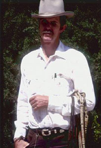 Rick Taylor with braided rawhide pieces, May, 1989 [image courtesy of James S. Griffith]